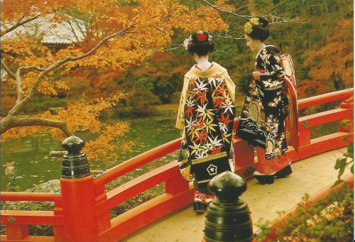 MAiko Girls standing at the garden of Daigo-ji Temple in autumn.jpg